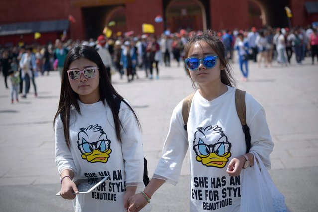 Two chinese women walk after visiting the Forbidden City in Beijing on May 3, 2015. (Photo by Wang Zhao/AFP Photo)