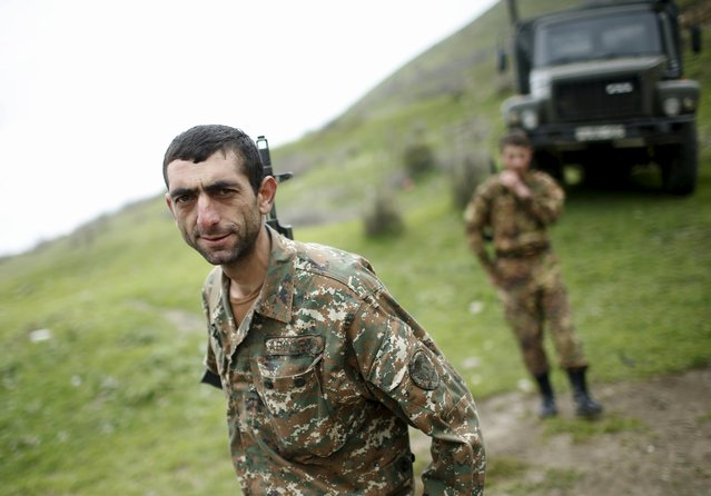 Servicemen of the self-defense army of Nagorno-Karabakh walk near their positions in the village of Talish April 6, 2016. (Photo by Reuters/Staff)