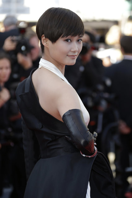 """Singer Li Yuchun poses for photographers upon arrival for the screening of the film """"The Little Prince"""" at the 68th international film festival, Cannes, southern France, Friday, May 22, 2015. (Photo by Joel Ryan/Invision/AP Photo)"""