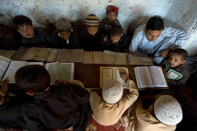 Internally displaced Pakistani children from tribal areas attend their daily lesson at a madrassa, a school for the study of Islam, on the outskirts of Islamabad, Pakistan, Monday, April 6, 2015. (Photo by B. K. Bangash/AP Photo)