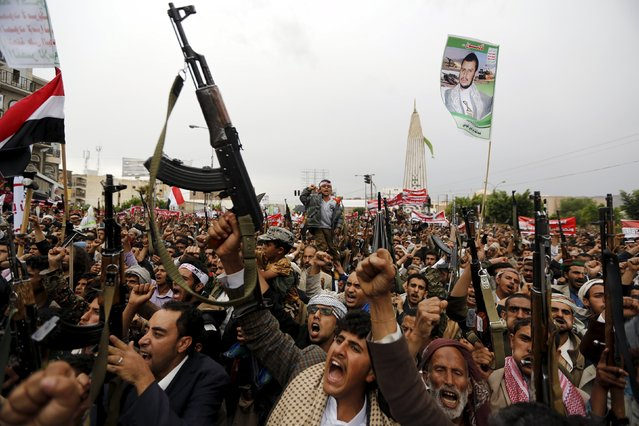 Houthi followers hold up their weapons during a demonstration against the Saudi-led air strikes, in Sanaa May 8, 2015. (Photo by Khaled Abdullah/Reuters)