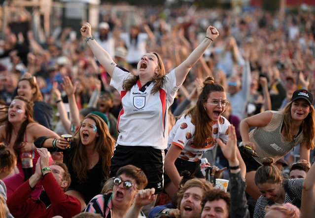 England fans react as they watch England's victory over Norway in the 2019 FIFA Women's World Cup quarter-finals on the West Holts stage during day two of Glastonbury Festival at Worthy Farm, Pilton on June 27, 2019 in Glastonbury, England. (Photo by Leon Neal/Getty Images)