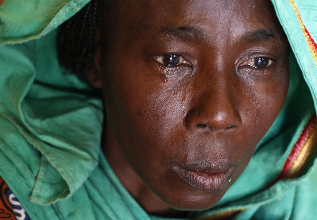 The mother of Altahir Ali cries after he was shot by French soldiers in Bangui, April 13, 2014. French soldiers shot Altahir Ali when they were searching his house for weapons in PK-12 area populated with Muslims, witnesses said. (Photo by Goran Tomasevic/Reuters)