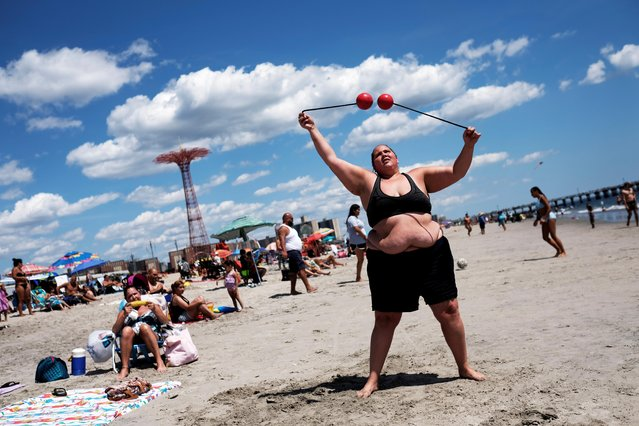 Yenne, 27, plays on Coney Island Beach in the Brooklyn borough of New York, U.S., August 11, 2019. (Photo by Nacho Doce/Reuters)