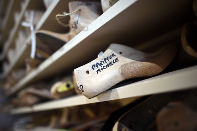 """This picture taken on April 22, 2014 in Paris, shows a form of shoe designed for US actress Michele Pfeiffer in the workshop of the """"Maison Clairvoy"""". Since 1945, the """"Maison Clairvoy"""" is specialised in the creation of luxury shoes and started in 1960 a collaboration with the famous Moulin Rouge to create boots and shoes for French Cancan dancers. (Photo by Franck Fife/AFP Photo)"""