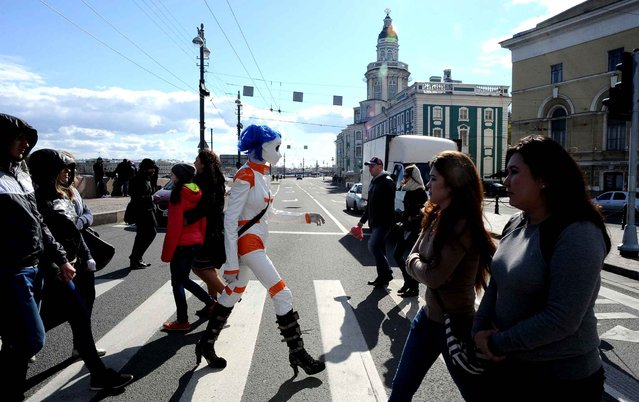 A Russian fan of Kigurimi, costumes inspired by cartoons, through a street of Saint-Petersburg. (Photo by SIPA Press)