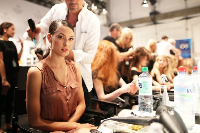 A model is seen backstage ahead of the Riani show during the Mercedes-Benz Fashion Week Berlin Spring/Summer 2016 at Brandenburg Gate on July 7, 2015 in Berlin, Germany. (Photo by Joern Pollex/Getty Images for Riani)
