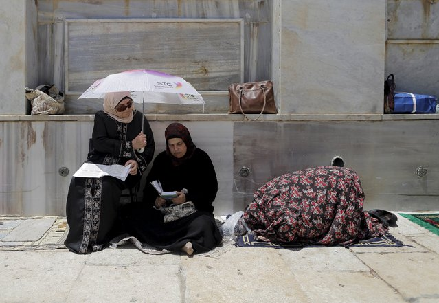 Palestinian women pray on the fourth Friday of the holy month of Ramadan at the compound known to Muslims as the Noble Sanctuary and to Jews as Temple Mount, in Jerusalem's Old City July 10, 2015. (Photo by Ammar Abdullah/Reuters)