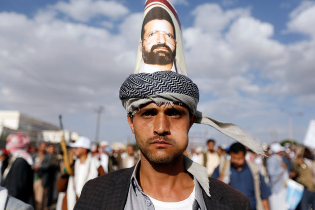 A Houthi follower sports a poster of the Houthi movement's founder, Houssein Badruddin al-Houthi, during a demonstration against the U.S. intervention in Yemen, in the country's capital Sanaa, May 13, 2016. (Photo by Khaled Abdullah/Reuters)