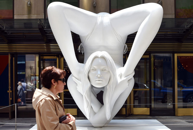 "A woman passes by a sculpture by Marc Quinn titled  ""Myth Venus"" before the start of the afternoon session auction May 14, 2014 at Christie's  Morning & Afternoon Session of Post-War and Contemporary Art in New York. (Photo by Timothy A. Clary/AFP Photo)"
