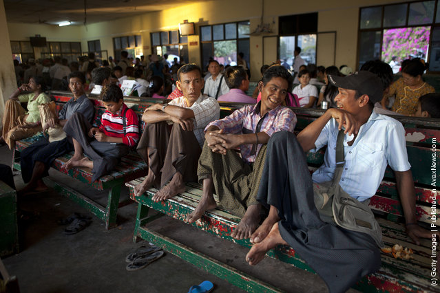Burmese men chat in the waiting room before boarding a Yangon ferry
