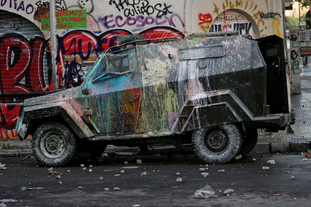 A vandalised riot police vehicle is seen during a protest against Chile's government in Santiago, Chile on October 30, 2019. (Photo by Henry Romero/Reuters)