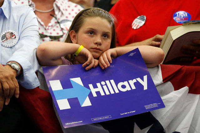 A supporter listens to U.S. Democratic presidential candidate Hillary Clinton speak at the University of California Riverside in Riverside, California, U.S. May 24, 2016. (Photo by Lucy Nicholson/Reuters)
