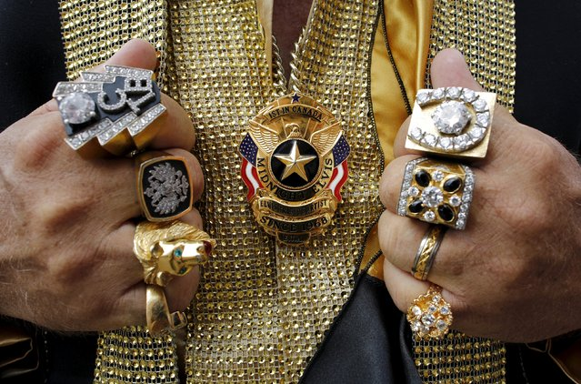 Canada's first Elvis Presley tribute artist Norm Ackland of London, Ontario poses with his heavy rings and a shield at the four-day Collingwood Elvis Festival in Collingwood, Ontario July 25, 2015. (Photo by Chris Helgren/Reuters)