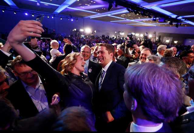 Andrew Scheer takes a selfie on stage after winning the leadership at the Conservative Party of Canada leadership convention in Toronto, Ontario, Canada, May 27, 2017. (Photo by Mark Blinch/Reuters)