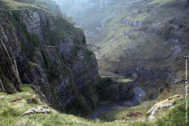 Motorists drive through the Cheddar Gorge