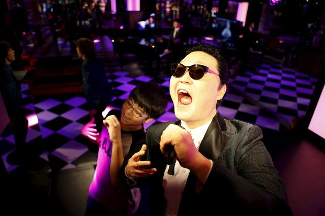 A boy poses for photographs next to the wax figure of South Korean singer Psy at Grevin Wax Museum in central Seoul, South Korea, July 30, 2015. French wax museum Musee Grevin has opened its first Asian branch in central Seoul with about 80 wax figures including those from hallyu (the Korean pop culture wave) displayed, according to local media. (Photo by Kim Hong-Ji/Reuters)