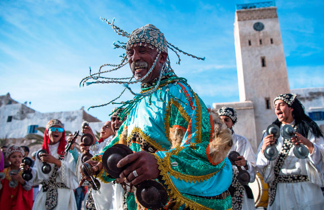 A Gnawa traditional group performs in the city of Essaouira on December 14, 2019, to celebrate the decision of adding the Gnawa culture to UNESCO's list of Intangible Cultural Heritage of Humanity. (Photo by Fadel Senna/AFP Photo)