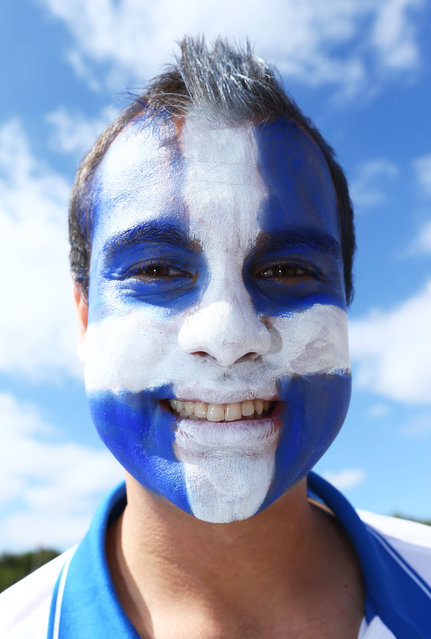 A Greece fan with a painted face enjoys the atmosphere prior to the 2014 FIFA World Cup Brazil Group C match between Colombia and Greece at Estadio Mineirao on June 14, 2014 in Belo Horizonte, Brazil. (Photo by Jeff Gross/Getty Images)