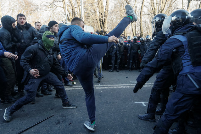 Activists of Ukrainian far-right movements attack police officers during a protest of agricultural workers against land reform in Kiev, Ukraine on December 17, 2019. (Photo by Valentyn Ogirenko/Reuters)