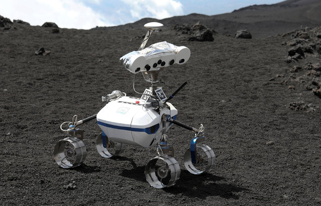 A robot is seen on Mount Etna, Italy on July 4, 2017. Mount Etna, in Sicily, is a test bed for the approximately three-foot high, four-wheeled machine ahead of a future mission to the moon. It is being conducted by the German Aerospace Centre, the agency which runs Germany's space programme. (Photo by Antonio Parrinello/Reuters)