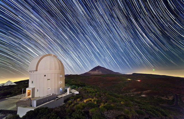 An undated long exposure handout picture made available by the European Space Agency (ESA) on 27 April 2014 shows the ESA's Optical Ground Station (OGS) housing the Lunar Lasercom Optical Ground System (LLOGS) at the La Teide Observatory on Tenerife, Canary Islands, Spain. (Photo by EPA/ESA)