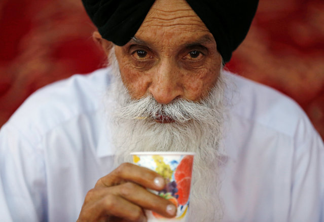 An Afghan Sikh man drinks from a cup inside a Gurudwara, or a Sikh temple, during a religious ceremony in Kabul, Afghanistan June 8, 2016. (Photo by Mohammad Ismail/Reuters)