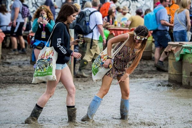 Festival goers arrive for the Glastonbury festival at Worthy Farm, in Somerset, England, Thursday, June 23, 2016. (Photo by Guy Bell/Rex Features/Shutterstock)