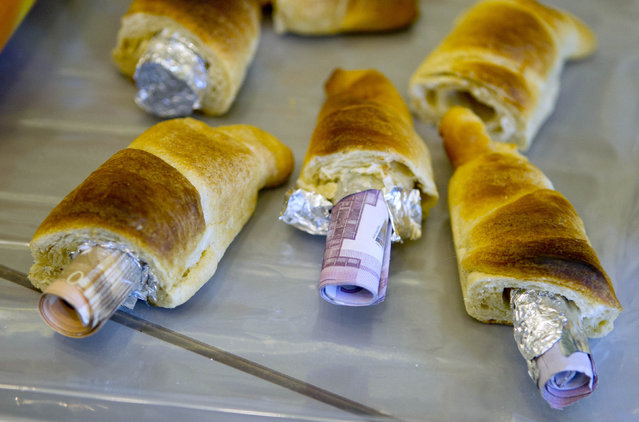 Money concealed in pastries that the German customs agency Zoll seized during an anti-money laundering operation, is displayed before the agency's annual statistics news conference at the finance ministry in Berlin March 16, 2012. (Photo by Thomas Peter/Reuters)
