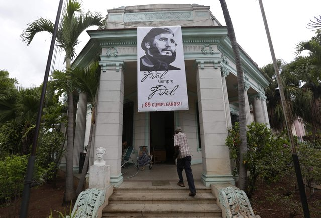 A banner with a picture of former Cuban President Fidel Castro is seen outside the state office in Havana, Cuba  August 11, 2015. Castro celebrates his 89th birthday on August 13, 2015. (Photo by Enrique de la Osa/Reuters)