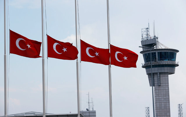 Turkish flags, with the control tower in the background, fly at half mast at the country's largest airport, Istanbul Ataturk, following yesterday's blast in Istanbul, Turkey, June 29, 2016. (Photo by Murad Sezer/Reuters)