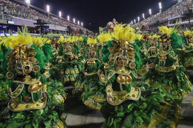 Members of Mocidade samba school perform during the second night of the Carnival parade at the Sambadrome in Rio de Janeiro, Brazil on February 25, 2020. (Photo by Ricardo Moraes/Reuters)