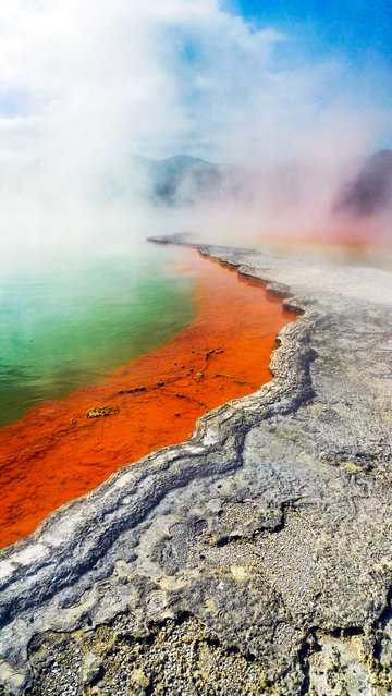 "Named after its constant fizzing of carbon dioxide bubbles reminiscent of champagne, ""Champagne pool"" is one of New Zealand's most well-known geothermal features. Despite it being 900 years old, it's relatively young for a hot spring and gets its distinctive orange colour from toxic mineral sulphides. (Photo by Nick Easton/BBC Pictures/The Guardian)"