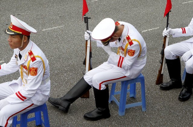 A member of the honour guard takes a rest during a parade marking Vietnam's 70th National Day at Ba Dinh square in Hanoi, Vietnam September 2, 2015. (Photo by Reuters/Kham)