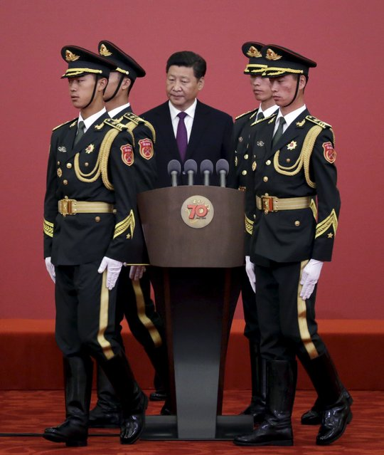 China's President Xi Jinping is pictured between soldiers from the honor guards at a medal ceremony marking the 70th anniversary of the Victory of Chinese People's War of Resistance Against Japanese Aggression, for World War Two veterans, at the Great Hall of the People in Beijing, China September 2, 2015. (Photo by Jason Lee/Reuters)
