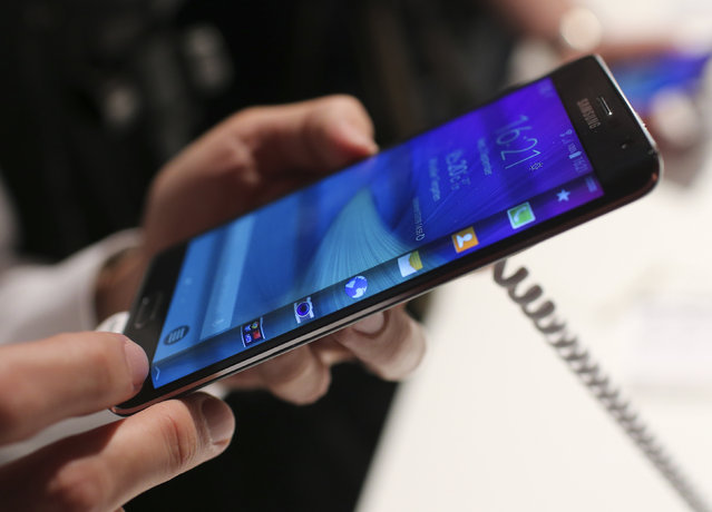 A visitor holds a new Samsung Galaxy Note Edge smartphone after its presentation at the Unpacked 2014 Episode 2 event ahead of the IFA Electronics show in Berlin, September 3, 2014. (Photo by Hannibal Hanschke/Reuters)