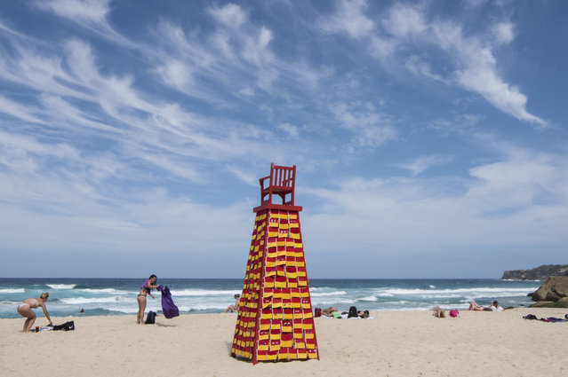 """""""Lookout for Me"""" by Linton Meagher on the sand at Tamarama Beach at Sculpture By The Sea on October 18, 2017 in Sydney, Australia. """"This work has been created with many volunteers from retirement homes across Sydney. Sewing a flag for their favourite beach invokes the notion of looking out for others: bridging seas, generations and communities"""". (Photo by James D. Morgan/Getty Images)"""