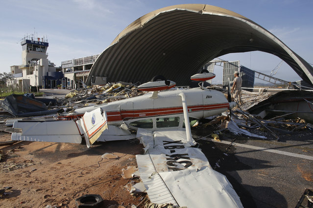 A plane destroyed by Hurricane Odile sits at Cabo San Lucas airport Mexico,  Wednesday, September 17, 2014.  Desperate locals and tourists were in survival mode in the resort area of Los Cabos on Wednesday, with electrical and water service still out three days after Hurricane Odile made landfall as a monster Category 3 storm. (Photo by Victor R. Caivano/AP Photo)