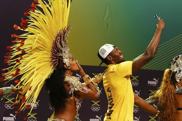 Jamaican track star Usain Bolt with Brazilian samba dancers at a press conference, August 8, 2016, Rio de Janeiro, Brazil. (Photo by Nacho Doce/Reuters)