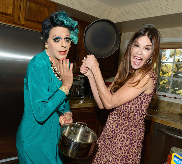 """Model Janice Dickinson (L) and artist/YouTube personality Sham Ibrahim perform during the """"What's Cooking With Sham""""cooking show on October 27, 2017 in Tarzana, California. (Photo by Tara Ziemba/Getty Images)"""
