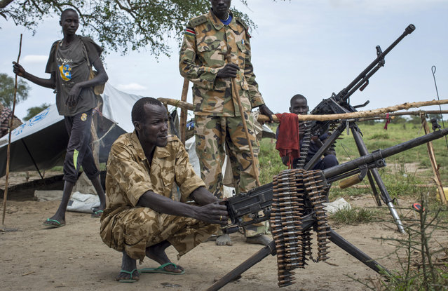 Rebel soldiers guard the village of Majieng, about 6km from the town of Bentiu, in South Sudan Saturday, September 20, 2014. Seyoum Mesfin, the chairman of the South Sudan mediation process said Saturday there is renewed fighting in South Sudan between government and rebel troops and that it is a purposeful act aimed at derailing the next phase of the peace process. (Photo by Matthew Abbott/AP Photo)