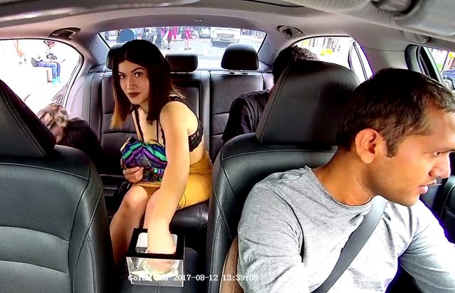 Bra-clad Uber passenger was caught on camera stealing from a driver's tip jar, while brazenly looking into the car's security camera in New York City, USA in August (issued November 7, 2017). The unnamed rider was with two others. When they got out she looked around as she grabbed dollars out of the jar. The driver then looked down after the three got out, but it was too late. The publication later reported that the woman's name is Gabita, and she's 18 years old. (Photo by YouTube/The Epochtimes)