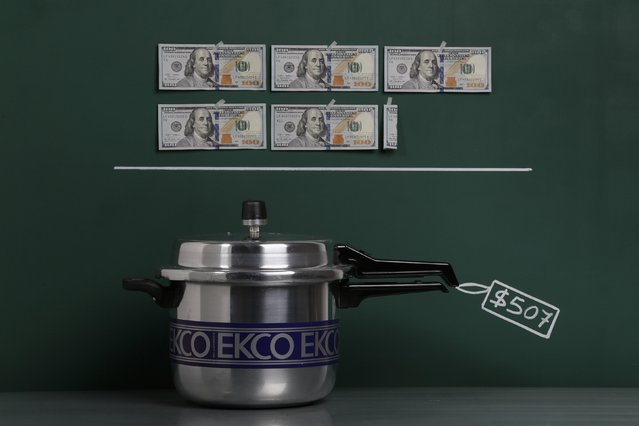 An aluminium pressure cooker as photographed in a studio with an illustrative price tag of $507 (US dollars), equivalent to the Bs. 3,200 (bolivars) that it costs on average to purchase in Caracas at the official exchange rate of 6.3 bolivars per dollar, in Caracas September 29, 2014. (Photo by Carlos Garcia Rawlins/Reuters)