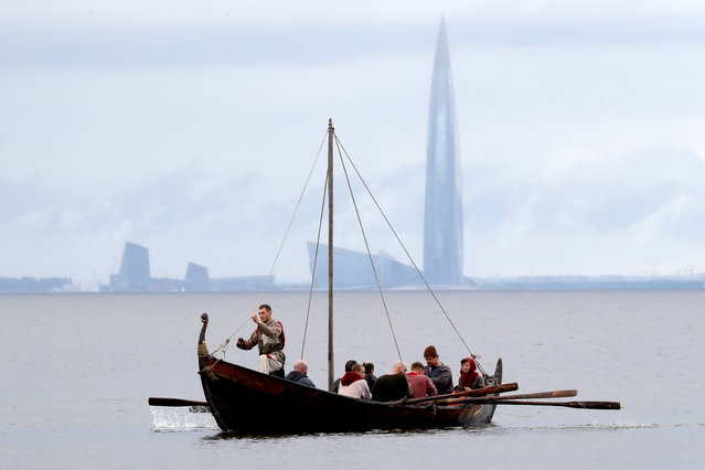 Members of the Rus marine unit of the Historical Reenactment Club sail the Volkhov (Magi) boat in the Neva Bay in St Petersburg, Russia on July 5, 2020. (Photo by Peter Kovalev/TASS)
