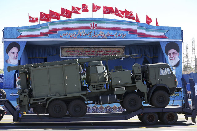 In this April 17, 2016 file photo, a long-range S-300 missile system is displayed by Iran's army during a parade marking National Army Day, in Tehran, Iran. State media says the military has begun deploying a Russia-supplied S-300 air defense system around the underground Fordo nuclear facility. Video footage posted late Sunday, Aug. 28, 2016, on Iranian state TV's website showed trucks arriving at the site and missile launchers being aimed skyward. Russia began delivering the S-300 system to Iran earlier this year after sanctions were lifted under a landmark nuclear agreement with world powers. (Photo by Ebrahim Noroozi/AP Photo)