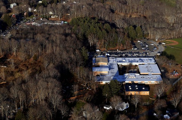 The school in Newtown is surrounded by woods. (Photo by Julio Cortez/Associated Press)