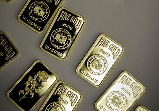 10 gram gold bars with a purity of 999.9 have been pressed and stamped with the  «Emirates Gold» company logo in Dubai, United Arab Emirates. Dubai now has about a 29 percent market share of global gold trade with nearly 1,200 tons – worth about $41 billion – changing hands annually at the city's gold markets, according to the gold industry website bullionstreet.com. (Photo by Kamran Jebreili/AP Photo)