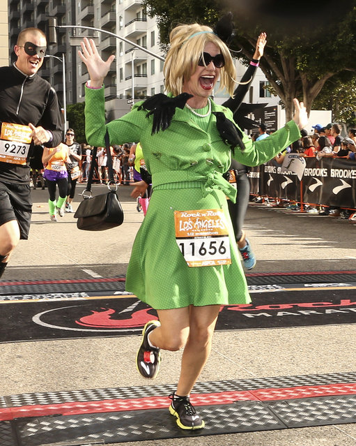 Actress Andrea Barber crosses the finish line at the Rock 'n' Roll Los Angeles Halloween Half-Marathon and 5K benefitting the ASPCA on October 26, 2014 in Los Angeles, California. (Photo by Rich Polk/Getty Images for CGI)