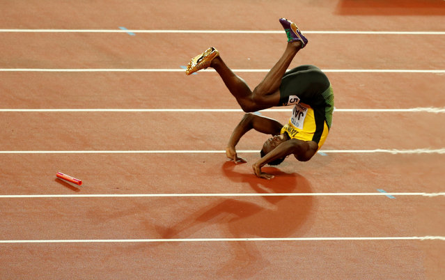 Usain Bolt of Jamaica falls down injured in the Men's 4 X 100 meters relay final during the World Athletics Championships at London Stadium, August 12, 2017. (Photo by Matthew Childs/Reuters)