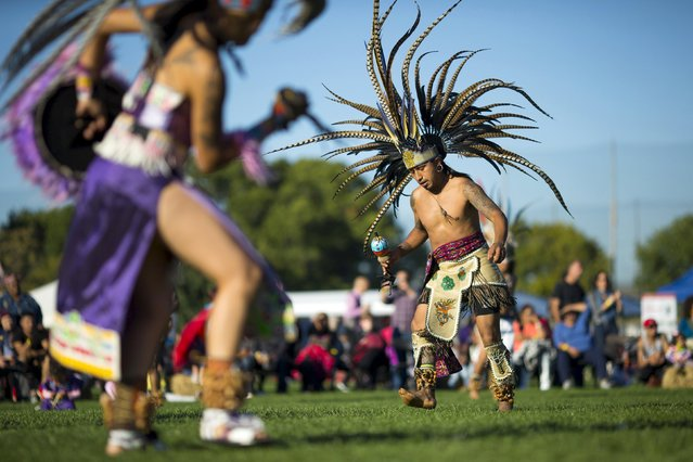 "Revellers dance during a ""pow-wow"" celebrating the Indigenous Peoples' Day Festival in Randalls Island, New York, October 11, 2015. The festival is held as a counter-celebration to Columbus Day and is to promote Native American culture and history. (Photo by Eduardo Munoz/Reuters)"